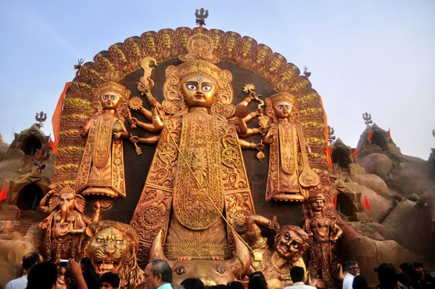 Durga Puja 2011 was celebrated in Kolkata on a grand scale. This is the 48 feet high fibre-glass Durga idol at FD Block, Salt Lake, depicted in the center of the artificially created Kailash mountains. These days the most popular Durga Puja``s are inaugurated on Tritiya itself i.e. the third day after Mahalaya, and the crowds start visiting the pandals from Chaturthi till Dashami. The main puja days are on Saptami, Ashtami and Navami.