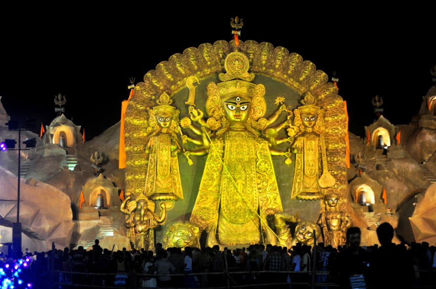 The FD Block puja at night. This picture was taken on Maha-Ashtami, which witnesses the maximum crowds. Lakhs of people visit the pandals on Ashtami night. The pandals are temporary structures made of bamboo /cloth, which serve as a temple for the goddess. Many of them are planned and designed over 5-6 months.