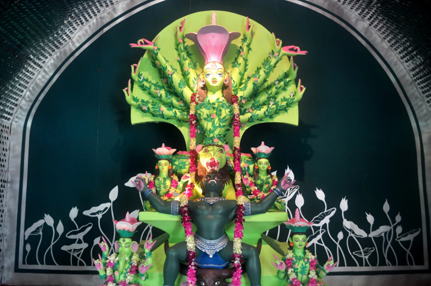 The Durga idol at Adibashi Brinda, Lake Town, shows the goddess relinquishing her weapons, after killing Mahisasura. Here too, the theme revolved around the destruction of the environment.