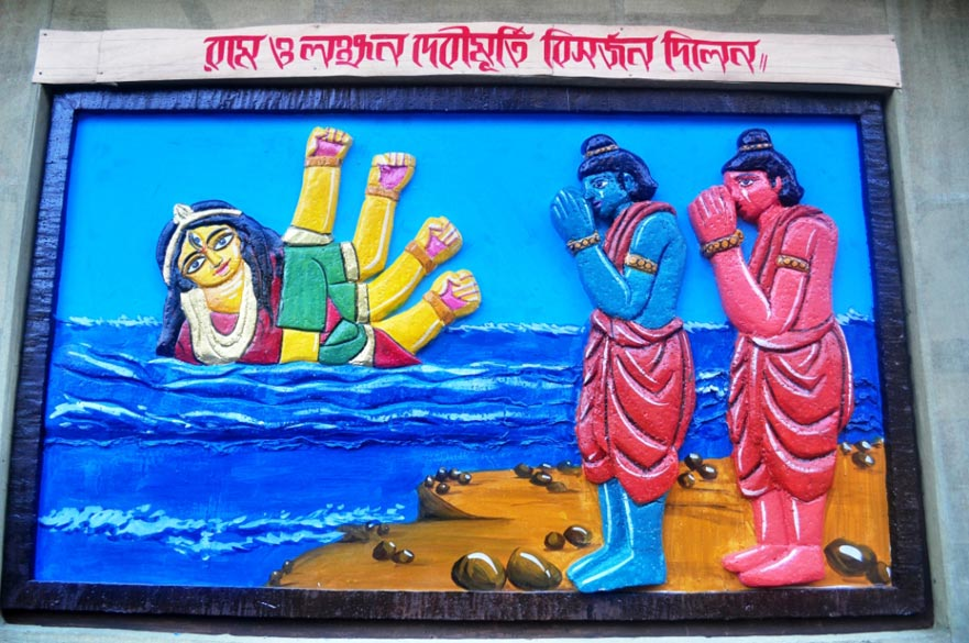 Themes from the Ramayana are very popular at many pandals. This is because the Durga Puja is based on Lord Rama``s invocation of the goddess Durga before embarking on his battle against Ravana. Originally, Durga Puja used to be celebrated in March-April, a practise that is still followed in many parts of rural Bengal (Basanti Puja). In this image from HB block, Salt Lake, Rama and Laxmana are shown immersing the Durga idol.