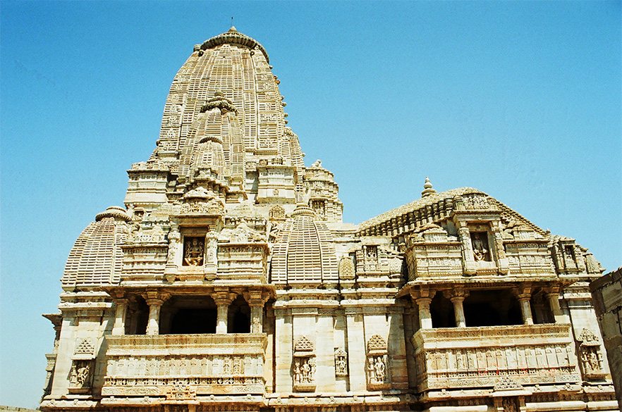 In front of the temple is an icon of Garuda under a canaopy supported by four pillars. Originally a Sun mandir was constructed in 8<sup>th</sup> century A.D. in the time of Bappa Rawal. A Khilji destroyed it in 1303, renovated by Rana Kumbha. It was destroyed again by Akbar in 1568 a.d. Mandir stands on a chariot. A side view of the mandir.