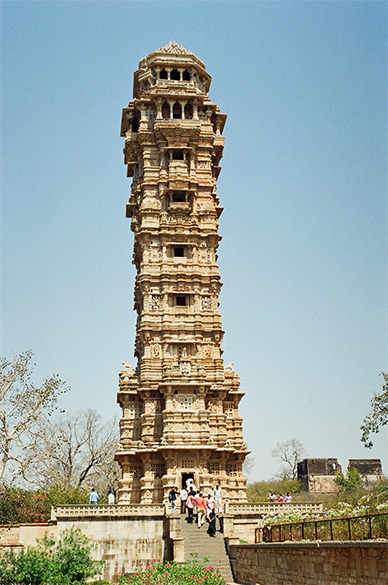 You see Vijaya Stambha. It was also used as a watchtower, built like a 'Damroo'. It is 37 mtrs in height, has a girth of 30 feet at the base, is 9 storeys and has 157 steps. Rana Kumbha built it in 1440 to commemorate the victory over the combined forces of Malwa & Gujarat. It cost Rs 90 lakhs to make then.