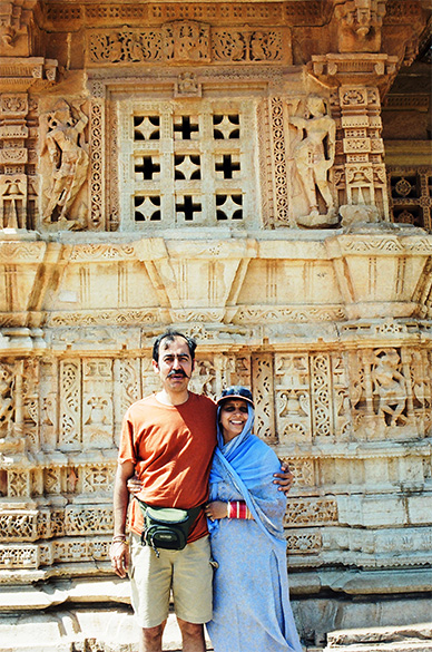 Wife Aparna & I standing in front of Vijaya Stambha. Note the intricate carvings at all levels. This was also used as a watch tower.