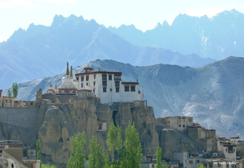 Lamayuru Monastery is enroute Srinagar-Kargil-Leh highway, on a steep rock mountain. It is the oldest and most interesting monastery of Ladakh. It is stunningly located amidst dusty mountains with a bizarre texture, likened to a moonscape. It belongs to the Red-Hat sect of Buddhism and houses approximately 150 Buddhist monks.