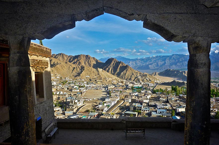 A Framed World View : This is a view from the Leh Palace, overlooking the old town area of Leh. Abandoned several decades ago, this palace houses no ruler or government today, but standing in one of these windows one can see the panoramic view the king of Ladakh would have once had over his bustling city. Embedded in the lap of the Karakoram range, Leh appears serene and protected despite its extreme climatic conditions.
