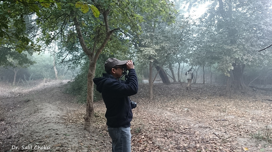 According to Sir Peter Scott, Keoladeo Sanctuary is the world's best bird area; and a favourite amongst ornithologists. ``Bharatpur Bird Sanctuary is called Keoladeo Ghana National Park. It is a reserve that offers protection to faunal species as well``. U see me trying to spot birds.