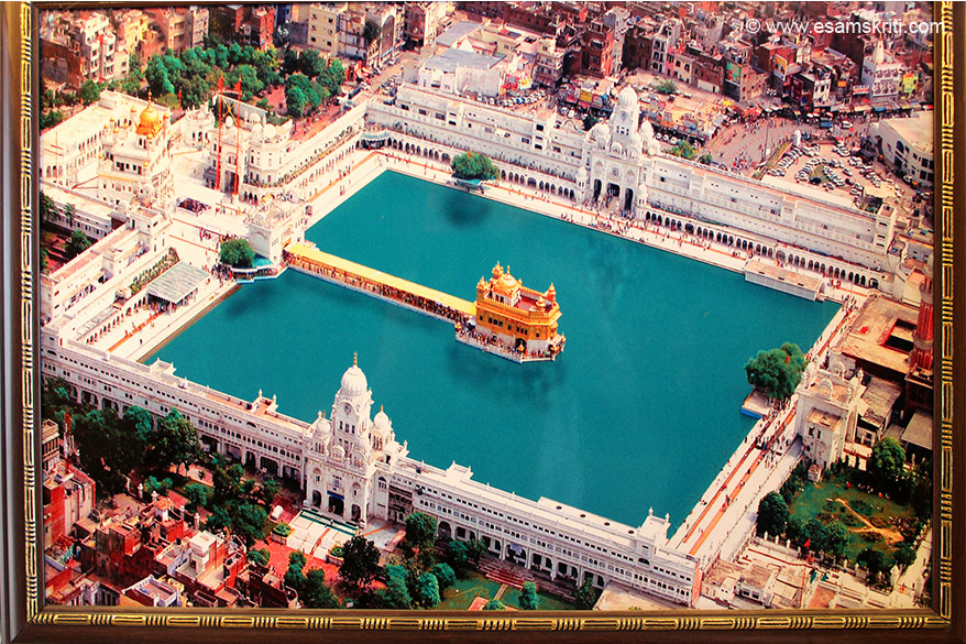 Helicopter view of the Golden Temple. This pic is found in many shops. Extreme right is east side entrance. Walk clockwise to see the watchtower on south side. Just outside watchtower is a ancient Shiv