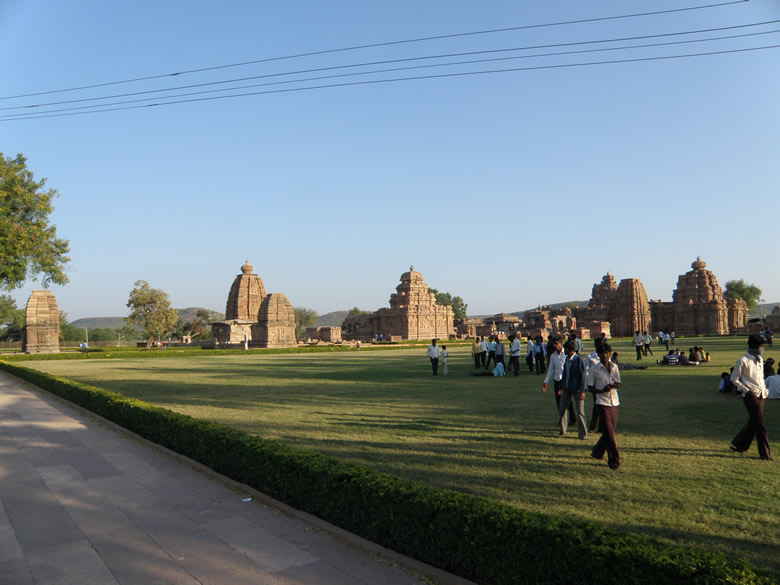 Pattadakal is less than an hour`s drive from Badaumi which is about 3 hrs drive from Hubli. The monuments here are a contribution by the Chalukyas of Badaumi. It lies on the banks of the river Malaprabha, is a world heritage site. You see an overview of the temple complex., Left to right is Kadasiddeshwara T, Jambulinga T, Galaganath T, Sangameshwara T, Virupaksha T, Kashi Vishveshwara T and Mallikarjuna T. The Papanath Temple is a few minutes walk from this complex. There is a Jain Temple ie a few minutes drive. Temples made here mark the blending of the Rekha-Nagara-Prasada and the South India Vimana styles of temple building. Vibrant and graceul sculptures provide panoramic glimpses of the contemporary society in its various dimensions.