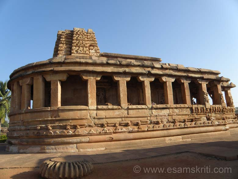 Aihole is known as the Cradle of Indian Temple Architecture. U see Durg Temple. With its back resembling the hind part of an elephant it has a fallen shikhara. It is built on the lines of the Buddhist Chaitya with an apsidal shaped cella shaped over which rises like a shikhara. The temple is surrounded by a parapet and short pillars that (you see) support the devakoshtas, mantap pikars and other images. Made in 742 A.D. The shape reminds me of Parliament House New Delhi.
