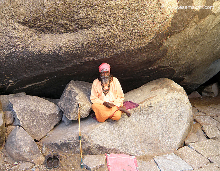 A few kms away from Hampi and across the Tungabhadra river is the fortress town of Anegundi, which pre-dates the Vijayanagar Empire. Here is Anjanadri Hill believed to be the birth place of Lord Hanuman. As you turn from the main market to the river saw this man dressed in Sadhu robes. Do not think he is a Sadhu but he is happy to be clicked and wants a donation  after that. Poses well for pics.