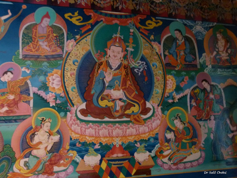 At Stakna monastery. A Thangka is a Tibetan silk painting with embroidery, usually depicting a Buddhist deity, scene, or mandala of some sort. The thankga is not a flat creation like an oil painting or acrylic painting but consists of a picture panel which is painted or embroidered over which a textile is mounted, over which is laid a cover, usually silk. Generally, thankgas last a very long time and retain much of their lustre, but because of their delicate nature, they have to be kept in dry places where moisture won``t affect the quality of the silk. It is sometimes called a scroll-painting.