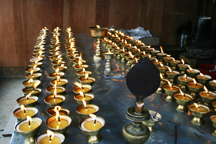 Butter lamps burning inside the Kyichu Lhakhang.