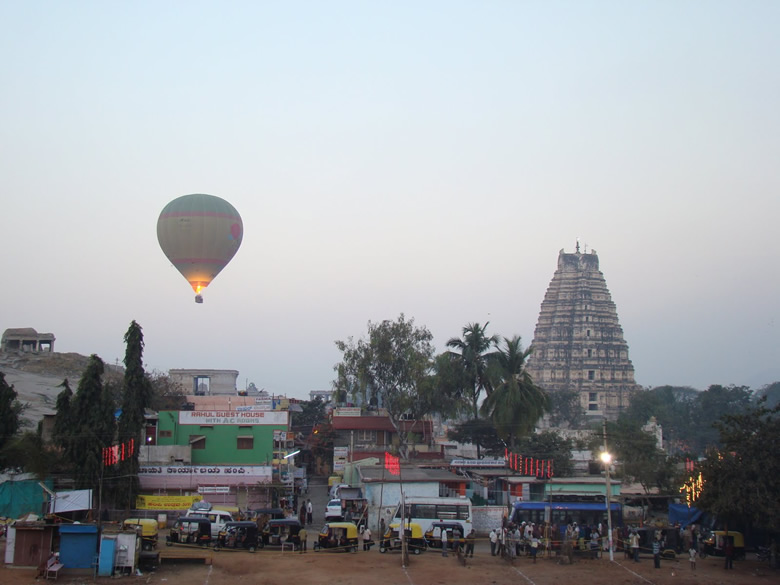 Bottom is bus stand. The small lane in centre of picture is where u have number of good guesthouses notably Padma, Santosh and Ranjana. On right is Virupaksha Temple.
