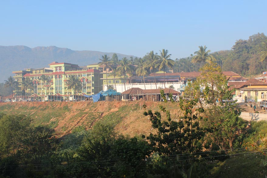An overview of the temple complex Hornadu. Green building extreme left is the temple guest house.  The white wall that u see behind the trees on left of pic is the temple wall. The ancient temple