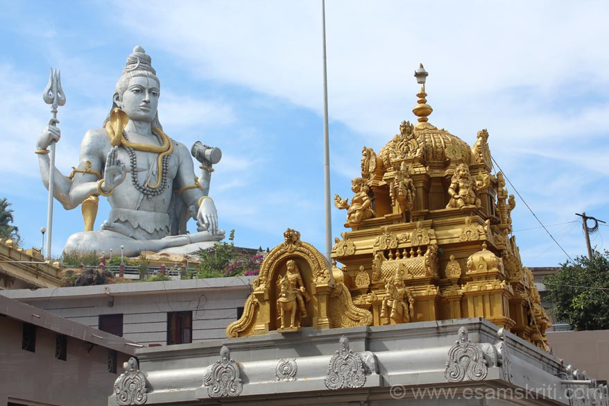 This is the vimana of the main Murdeshwar temple in the background is Lord Shiva. The presence of Lord Shiva is felt throughout Murdeshwar. The huge image/gopura have made this small town a major/must visit tourist destination.