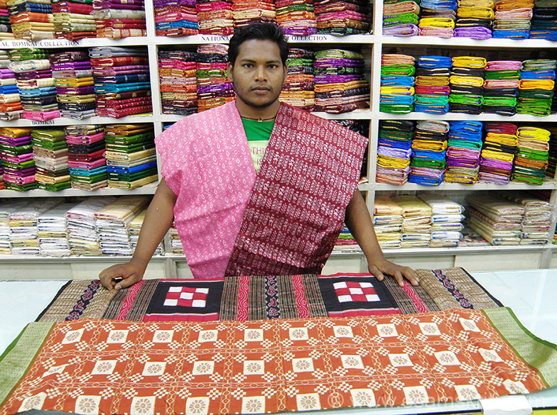 Ikat Sarees. ``Barpali, Bargarh, Sonepur, Bomikhal are known centres of handloom sarees and textiles both in cotton and silk. Sambalpur, Berhampur, Mayurbhanj produce a striking range in Tussar silk. Tribal people of the state also excel in producing textiles of myriad hues using vegetable dyes``.