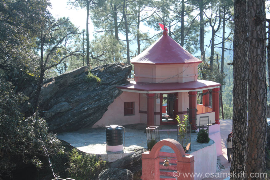 This is a rear view of the Kasar Devi mandir, a nearly 2000 year old Durga Mandir. The rock, a natural cave, was given the form of a temple in 1948.