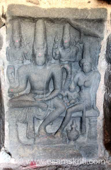 Somaskanda panel. Inside small gopuram - Shiva & Parvati with son Karthikeyan. Left is Brahma. Right is Vishnu.