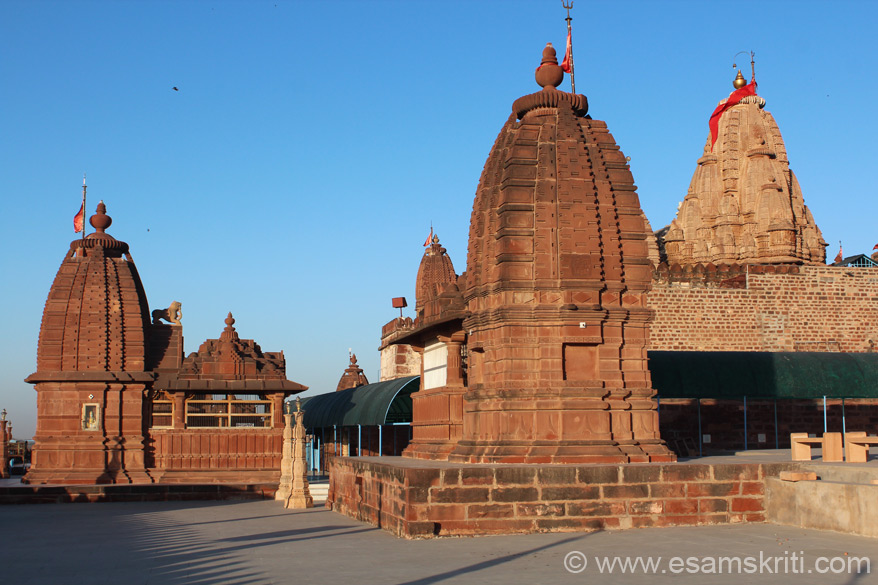 View of the temples that are part of the complex - taken against early morning sun rays. The length of the temple is 24 meters. On the lower parts of walls there is special ornamentation. A huge entrance hall and nine bracketed entrances beautify the temple.
