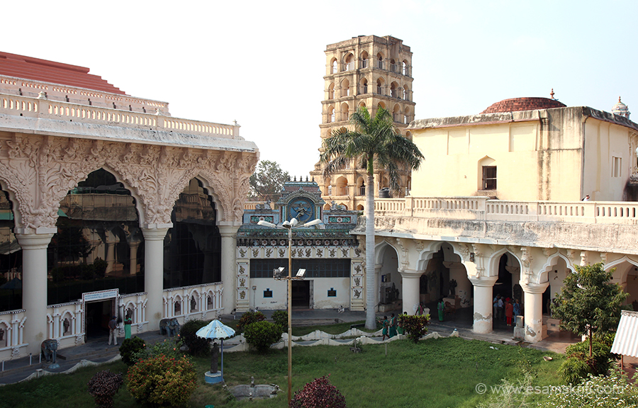 "Left of pic is Nayak Durbar Hall. Centre is Bell Tower. Right is art gallery.  ""This tower is also known as ""the wide holed ear pavilion"" to the public. It is also believed that the Vijayaraghava Nayakkar offered worship in the direction of Srirangam from the top terrace of this tower. ""Tower had more than 7 storeys which were damaged. ""A research note informs that there was a novel clock of sizable dimensions, forming part of the structure in which the figure of a monkey used to strike the gong every hour. The tower is fashioned in the style of Gingee Nayaks. """