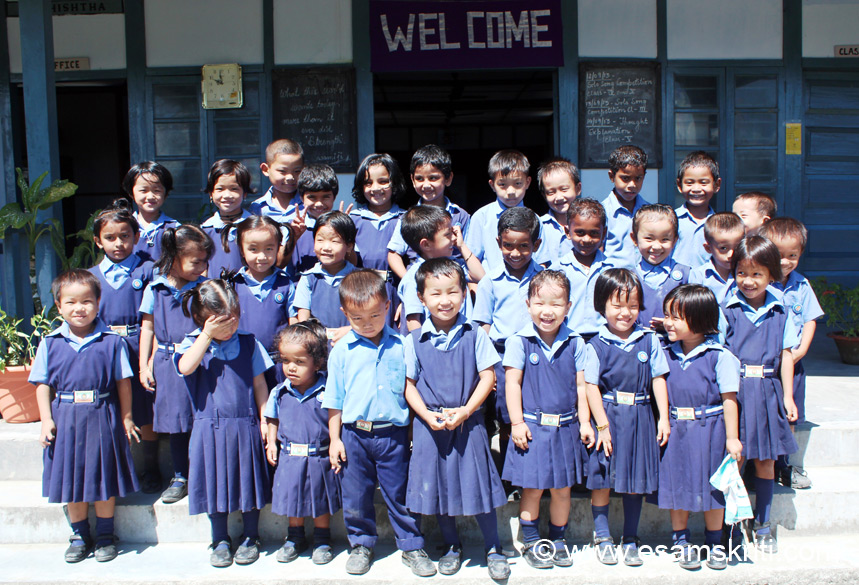In the same school are another group of primary students. It took some effort for the teacher to get the kids to stand as a group.
