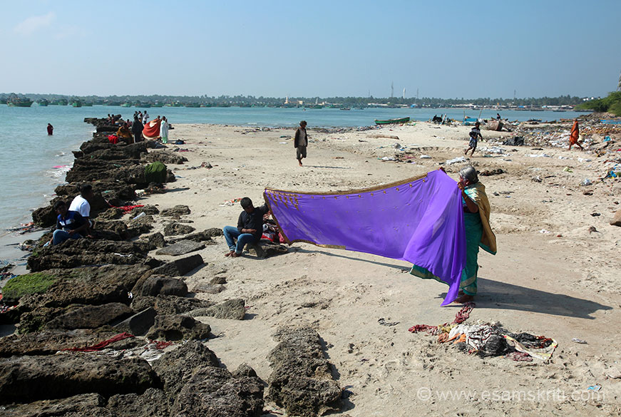 "It is a long beach. Lady drying sari after taking holy dip. ""The three most revered nayanmars [saivite saints] Thirunavukkarasar, Sundarar and Gnanasambandar have glorified Ramanathasamy with their songs."""
