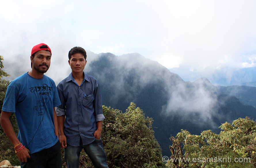 Left is driver Chandan Barua and a local boy who accompanied us. Since they are locals could survive the cold but I had my jacket out. Mayudia/Anini has snow-capped peaks, turbulent
