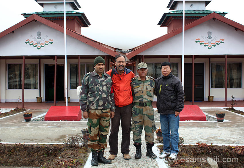 With a fellow traveller and Army personnel. The rooms that you see behind is where the India China border meetings are held.