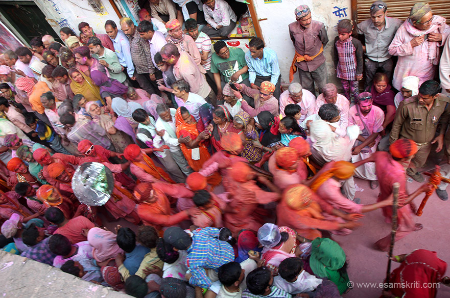 """Boys from Nandgaon rushing into venue after playing holi. """"People relive the stories of Holi associated with Radha and Krishna, play pranks as the young Krishna played with gopis. The underlying feeling of this fun-frolic was love and devotion."""""""