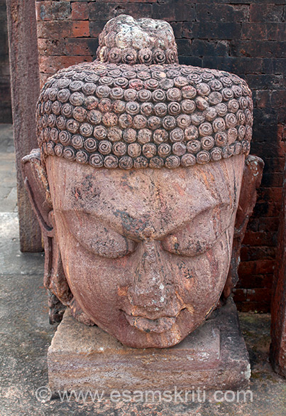 Stone image of Buddha inside monastery one.