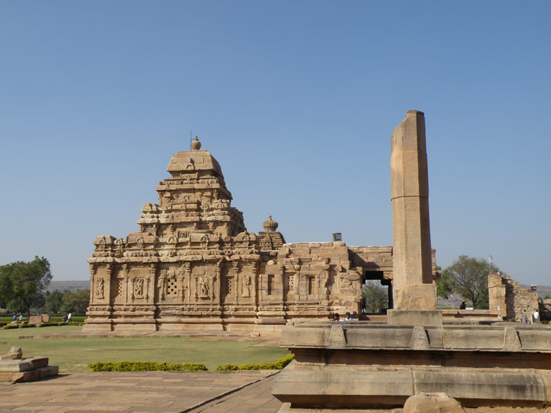 A two tier south Indian type of Shikar tops the shrine representing an experimental type of Vimana type immediately preceeding that of the Virupaksha and Mallikarjuna temples. The structure on the immediate right of the picture is Vijay Sthamb made when King Vikramaditya II defeated the Kanchi king. Very well made temple. The Nandi mandapa is outside the temple.