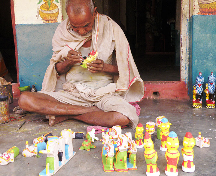 "A senior artist painting in his verandah. ""The word ""Patta"" means cloth and the word ""Chitra"" means a picture. Thus Patta chitra is a form of painting that is done on cloth. The art form can be traced to as early as the 12th century A.D and has evolved around the Jagannath tradition in Orissa."" To read more <a href=""http://orissa.oriyaonline.com/patta_chitra.html"" target=""_blank""> Click here </a>"