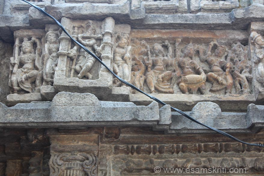 Close up of panel shows dancing women, probably Lord Krishna with a flute in the Champadevi temple.