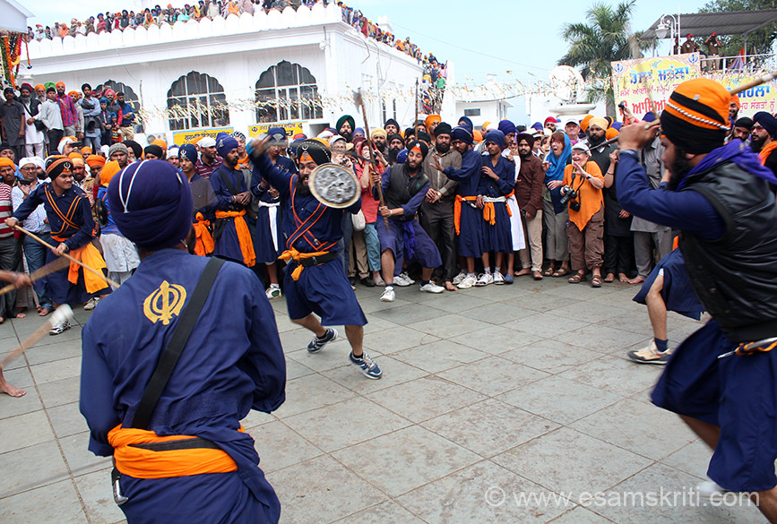 Warrior in the centre being attacked from all sides. ``Gatka is a complete martial system which uses spiritual, mental and physical skills in equal portions to help one defend themselves and others``.