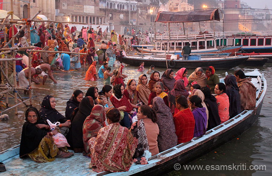 Lady devotees in boat for an early morning ride in the Ganga. The best time to go boating in the Ganga is early morning.