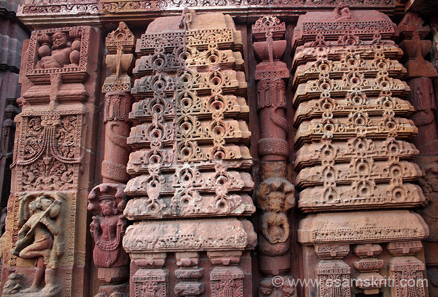 Sculptured relief on left of jagamohana. Left of pic shows women with musical instrument in hand.