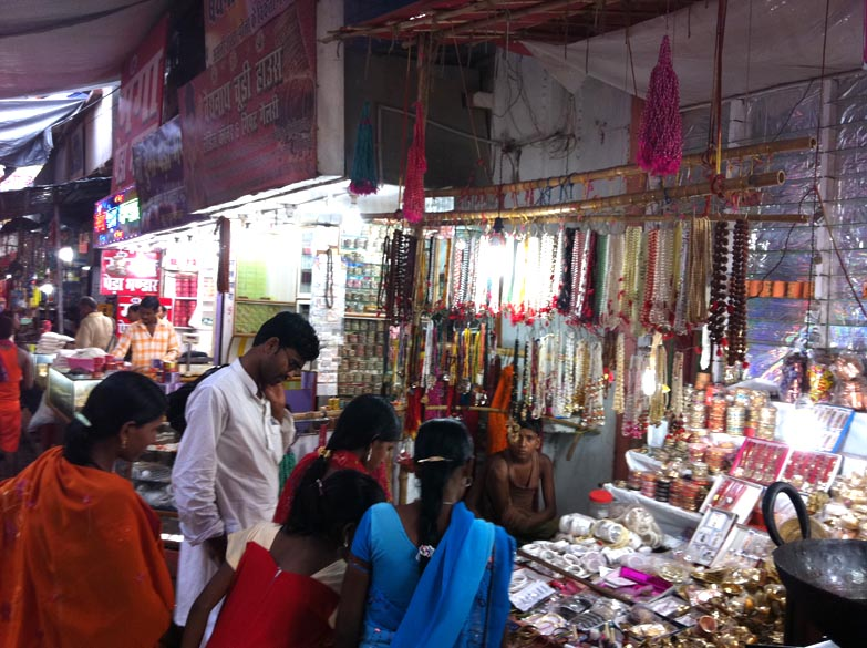 Due to the large number of devotees who visit temples areas close by have number of shops that sell local goods and street foot. This shop selling bangles, artifical jewellery.