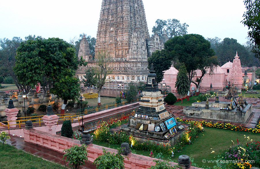 "Another view, see stupas in front. Marble walk way at higher level, next grass slope, another walkway paved with red stone that u see and then into the main temple.  ""The Bodhisattva 