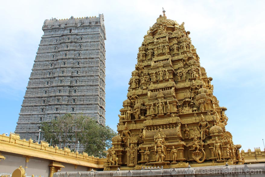 A close up of the temple vimana against the Raja Gopura.