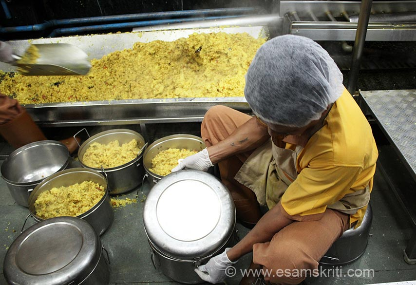 Shovel is used to fill pulao in steel utensils. It is locked there and then as you see in pic. ISKCON Food Relief Foundation works in 8 states, has 20 branches and feeds 12 lakh children daily. From this kitchen about 60,000 children are fed daily, in Maharashtra number is app 2,75,000. States are Andhra Pradesh, Madhya Pradesh, Delhi, West Bengal, Rajasthan, Maharashtra, Jharkhand and Haryana.