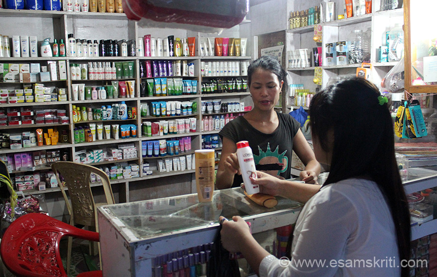 In Daporijo market. This shop has all the shampoos and cosmetics that a consumer can ask for. This lady spent about Rs 250/ to buy 2 bottles of L``Oreal shampoo. Thanks to TV they are 