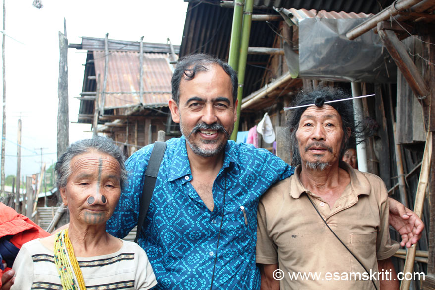 Visited many tribal homes in Ziro. U see me with a Apatani couple. Lady sports a tatoo and nose plug as described earlier. Every lady I saw had beads ka strings round their neck. The 