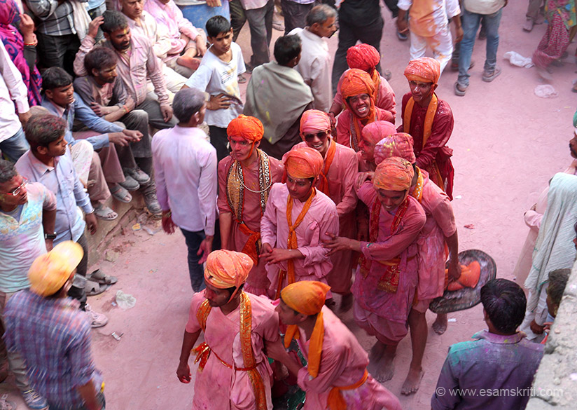 """Young boys of Nandgaon with shields to protect themselves from the ladies of Barsana. """"The women of Barsana village near Mathura in Uttar Pradesh beat up men from neighbouring Nandgaon village with sticks, in what's known as Lathmar Holi."""""""