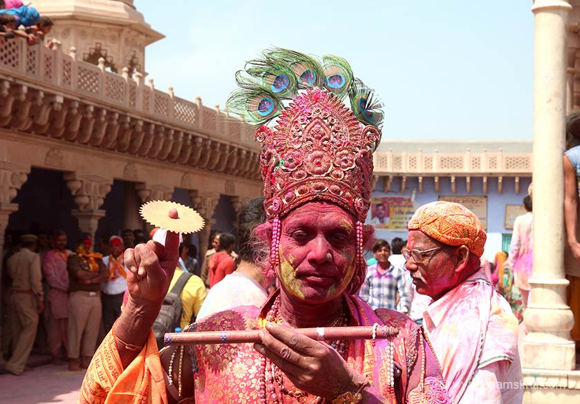 This man dressed up as Sri Krishna, Sudarshan chakra in hand, attracted a large number of photographers.