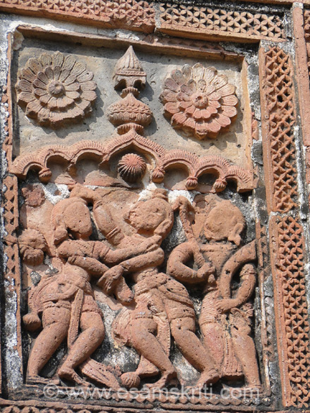 Artwork in temple wall. It is about 150 miles away from Kolkata and accessible by road  and partly by train.