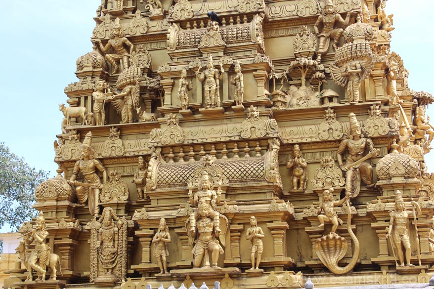 A close up of the scultures on temple vimana. It has images of Ravana, Krishna etc. Do not know if it is gold plated or colored in golden color.