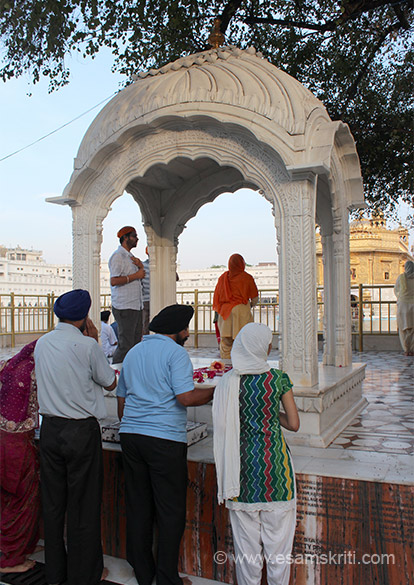 There is a raised platform which represents the sacred place. Devotees place roses and offer prayers here as you see.