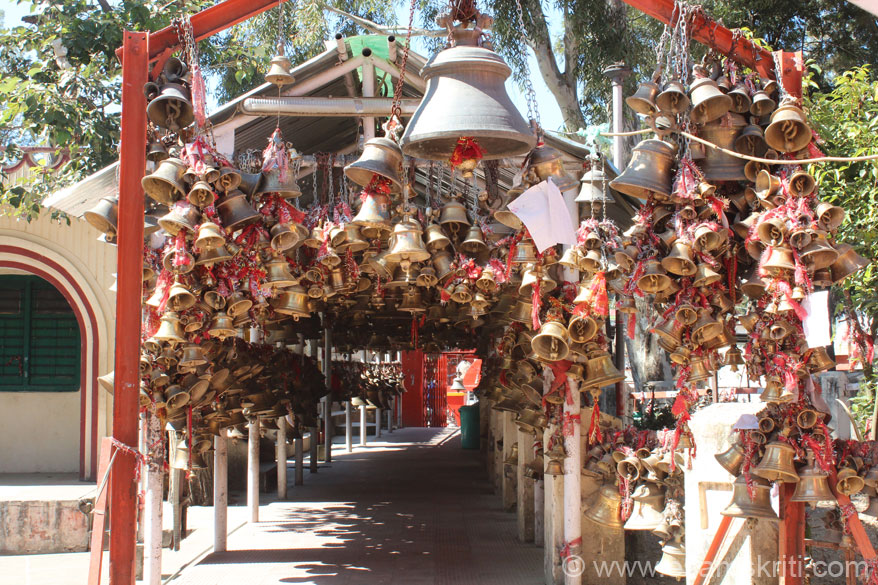View of bells from the temple side. These bells are hung by devotees as offerings making a wish or in thanksgiving on fulfillment of one's wish. To know more about Golu Devata <a target=_blank href=http://jaigoludev.blogspot.in/>Click here</a>