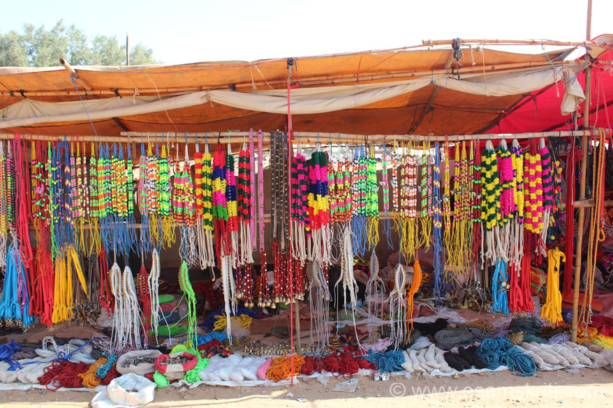 This is a shop that sells accessories for camels. Very colorful. Lots of them on both sides of the road.