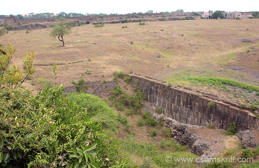 "From atop a bastion gives you view of one side of fort. Bottom centre of pic was a water tank. Water Harvesting is something ie seen in all Indian forts. Read Traditional Forms of Water Harvesting <a href=""http://www.esamskriti.com/essay-chapters/Traditional-Methods-of-Water-Harvesting-and-applicability-1.aspx"" target=""_blank"">Click here</a>"